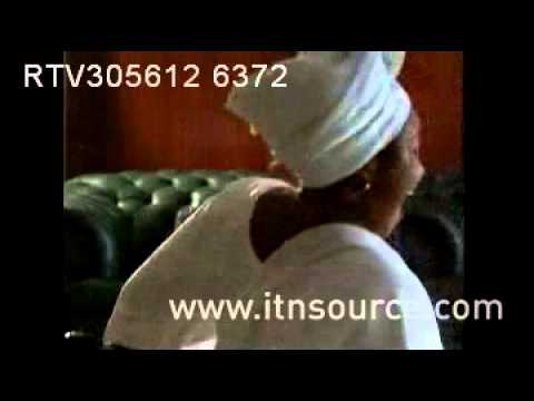 Kudirat Abiola Watching General Sani Abacha on TV 2