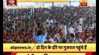 Watch PM Modi and CM Rupani wave at people in Rajkot