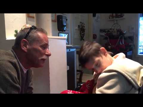 AMAZING--Brother-in-law gets mentally disabled sister-in-law to sing Rudolf the Red Nose Reindeer