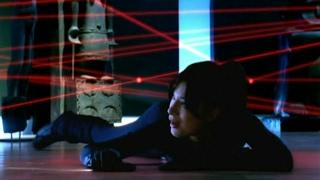 female burglar in a spandex catsuit