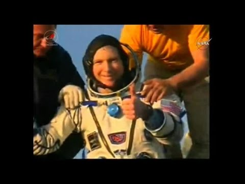 Astronauts land in Kazakhstan after delayed return from ISS
