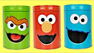 sesame-street-hide-seek-game-with-elmo-cookie-monster-oscar-the-grouch-surprise-tin-cans