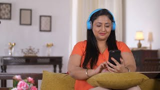 Indian fat woman listening to music and using her smartphone - Technology concept