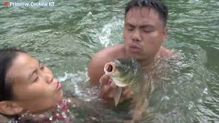 Survival skills catch fish by hand - Primitive technology cooking fish eating delicious