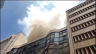 The fire started shortly after 1pm, on some of the upper floors, bu...