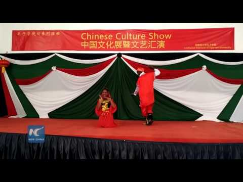 African girl performs Chinese Xinjiang folk song