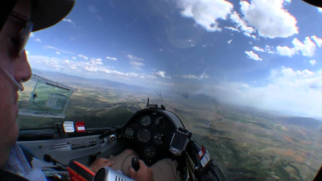 Glider flying in heavy turbulence over Utah mountains ...