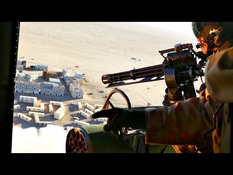 US Marines Helicopter Door Gunner in Action - Urban Close Air Suport