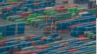 Loading containers on a sea cargo ship timelapse, view of the cargo port and container terminal of