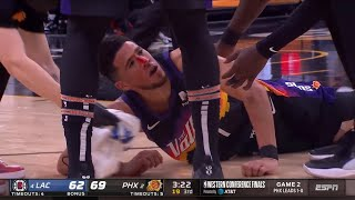 Devin Booker is down and bleeding pretty badly after colliding with Pat Beverley