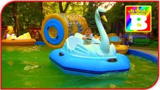 Funny SWAN walking on water in a Pool. OUTDOOR PLAYGROUND playcenter for Kids at Bogdan`s Show.