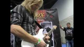 DIO/ Whitesnake guitarist Doug Aldrich trying out effects boxes at the NAMM show. 1 of 2