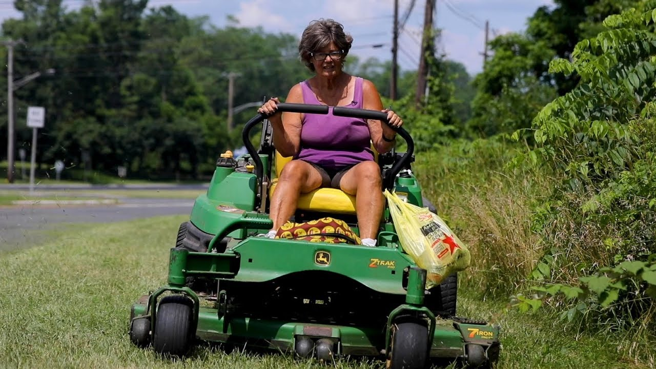 Grass-cutting grandma loves her town more than you can imagine