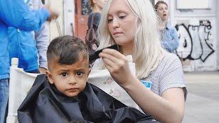 50 Friseure schneiden 300 Flüchtlingen die Haare