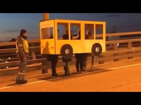 Otis - Group Of Pedestrians Dress As A Bus To Cross Vehicle Only Bridge