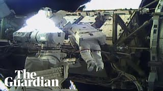 US astronauts venture outside ISS in Nasa's first all-female spacewalk – watch live