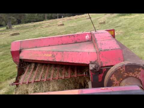 Massey Ferguson 165 baling with New Holland 268