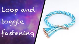 Learn how to make a loop and toggle fastening for kumihimo