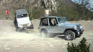 jeeps atascados en la presa rompepicos
