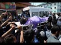 People carry the dead body of a civilian  who was killed after being run over by forces vehicle