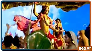 Krishna flaunts his muscular prowess carrying Govardhan Parbat on his little finger