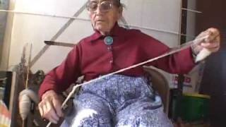 NAVAJO WEAVER CLARA SHERMAN CARDING AND SPINNING