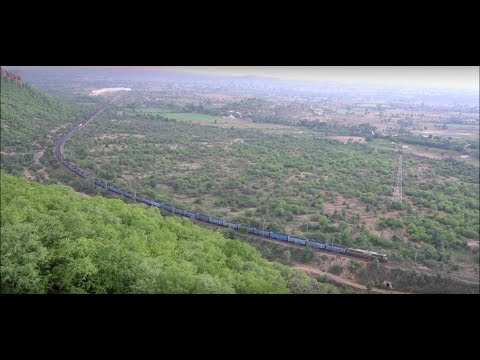 Simply Unimaginable ! 117 Wagon Python Train Going Over Another Train Captured from Above 500m !!!