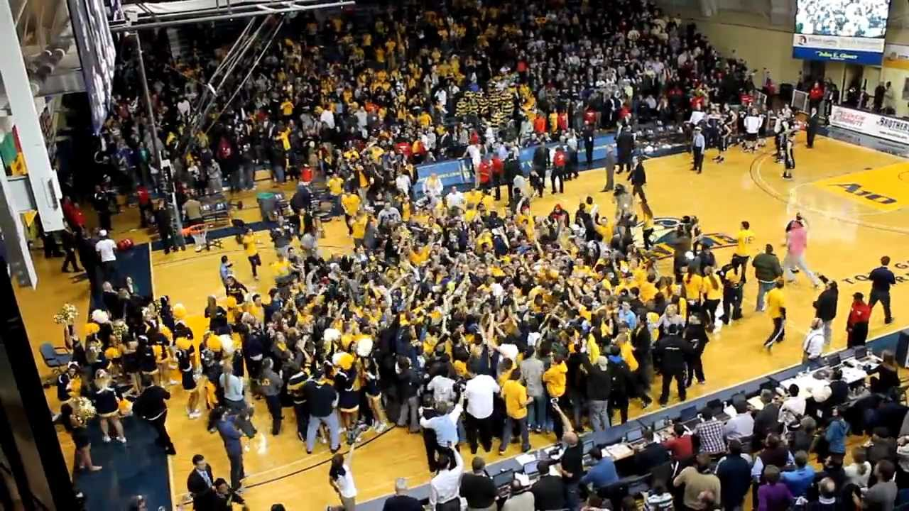 Students Rush Court at Tom Gola Arena