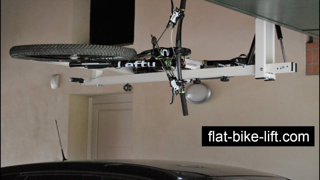 flat bike lift the ceiling hydro pneumatic bike rack doovi. Black Bedroom Furniture Sets. Home Design Ideas