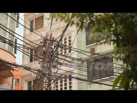 The web of power lines on the streets Hanoi City. Vietnam