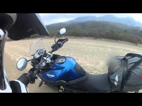 High speed motorcycle riding on gravel and dirt roads