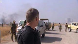 شاهد.. مراسل يُعلق وسط إطلاق النار بالموصل