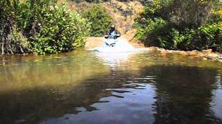 Yamaha YFZ 450 four wheeler quad crossing a little creek at Chappie Shasta OHV Park