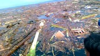 typhoon sendong survivors floating at ILIGAN BAY,seeking help..and rescued ALIVE..