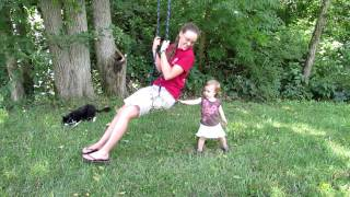 Sadie pushing Aunt Elizabeth on swing Thumbnail