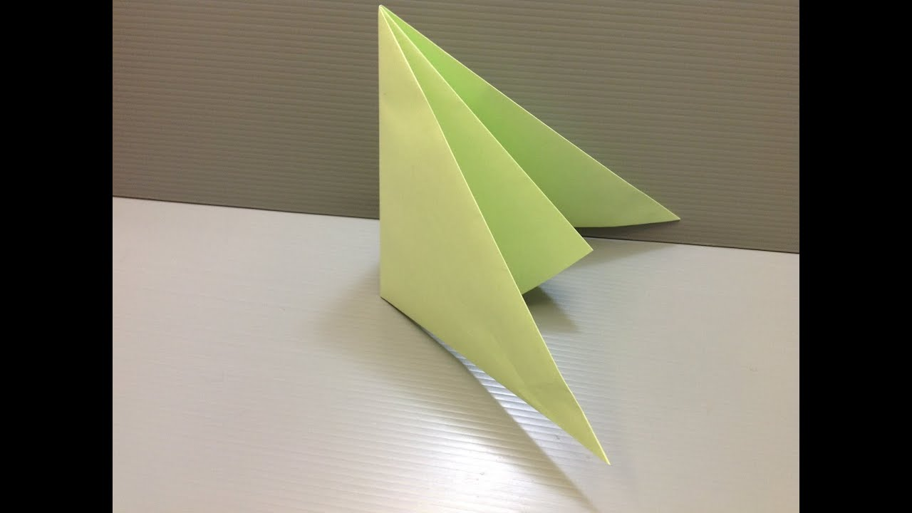 This video demonstrates how to make a loud and annoying paper popper. Prepare a regular sheet of paper and lay it down on the table or a flat surface. Fold the lower portion of the paper at about an inch and a half (