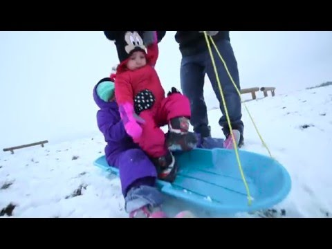 Sledding at Flat Fork Creek Park in Fishers, Indiana