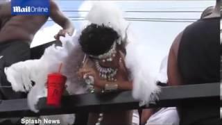 Rihanna in bejewelled bikini dances on a float at Barbados carnival