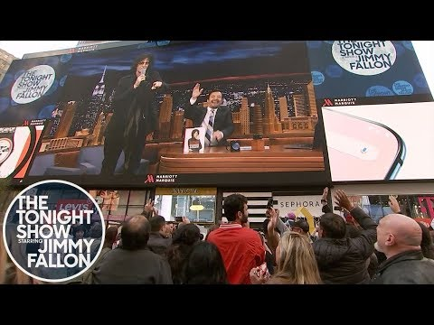 """Howard Stern and Jimmy Dance the """"Hokey Pokey"""" Live from a Times Square Billboard"""