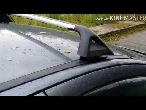 Обзор оригинальных багажных дуг Peugeot 308