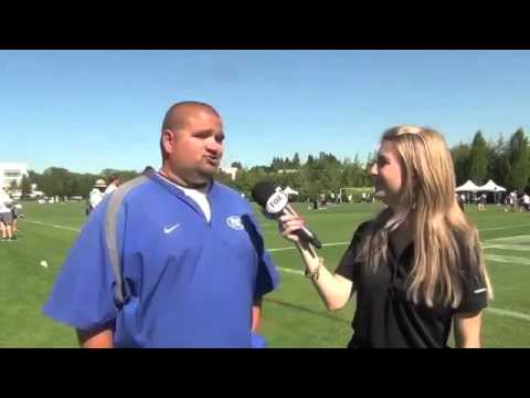 Girl Gets Bowled Over by Football Player While Interviewing! Ouch