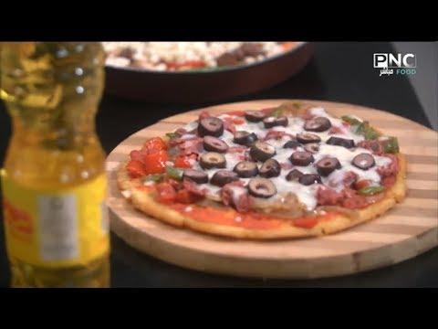 صورة  طريقة عمل البيتزا البلدي يوكل مع الشيف نونا | حلقة مخصصة عن طريقة عمل البيتزا بأسهل مكونات وحشوات طريقة عمل البيتزا من يوتيوب