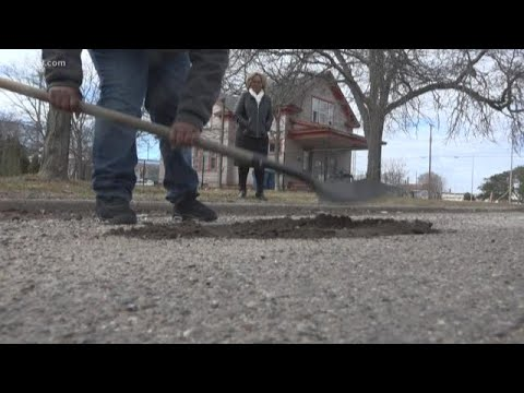 Rick Woodell - Muskegon Heights boy fills potholes on his street ! Will he come to Toledo?