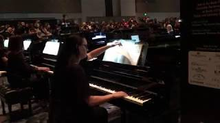 """The Sorcerer's Apprentice"" Piano Ensemble with 15 pianists at NAMM"