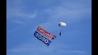 President Trump Boat Parade : Skydivers fly in record largest President Trump Flag.