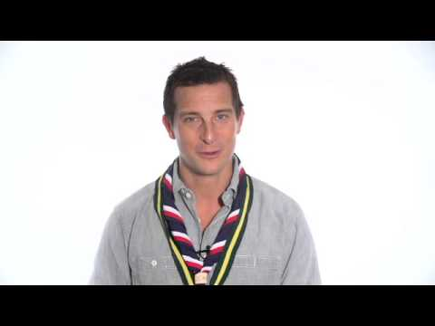 Bear Grylls congratulating Hampshire Scouting ambassador on becoming the first and only person to row an ocean, summit everest and cycle around the world.