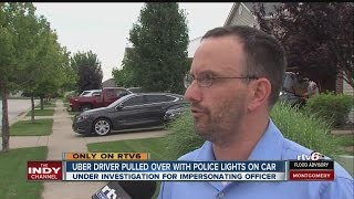 Uber driver pulled over with police lights on car