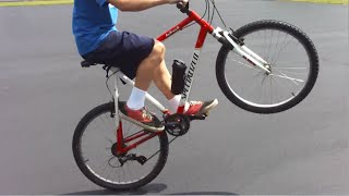 Specialized Mountain Bike Kid Riding Long Wheelies