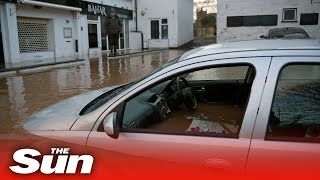 Storm Dennis: Cars swept away amid fears fifth person killed in flooding