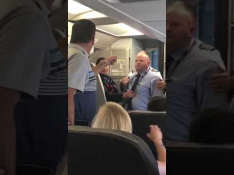 American Airlines Attendant and Passenger Almost Come to Blows